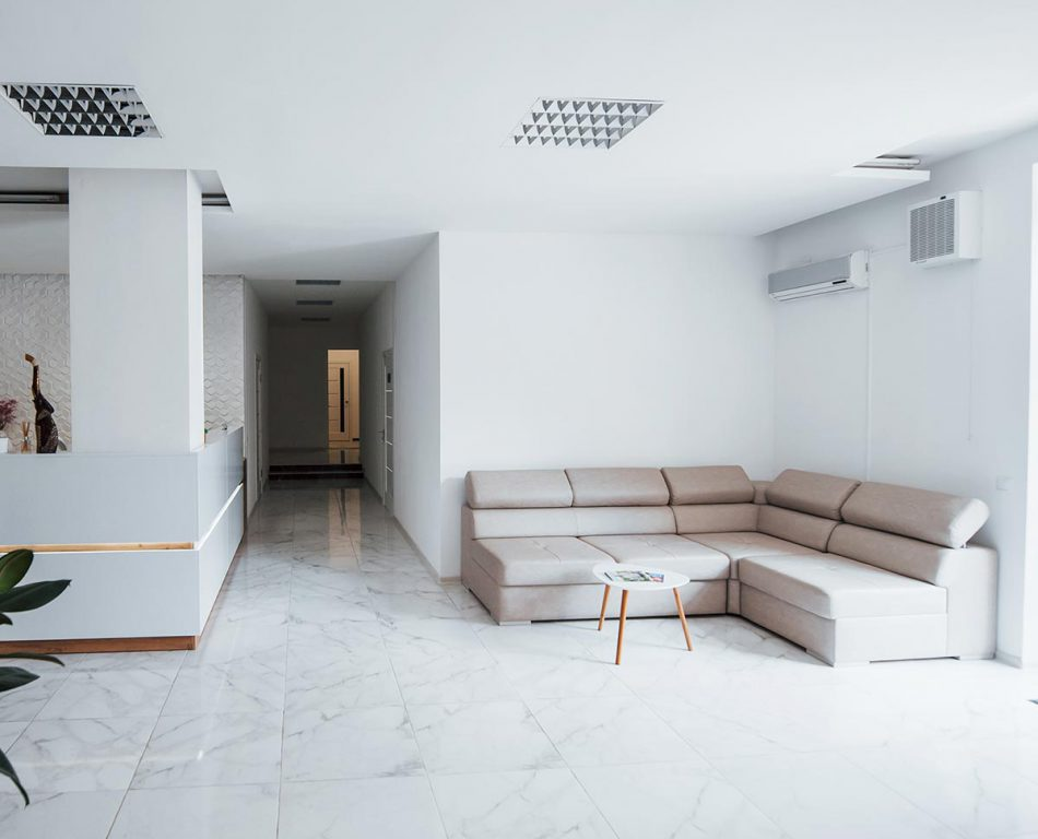 Interior of modern clinic waiting room at daytime. No people inside.